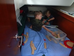 The boys are playing trains in Ethan's cabin.