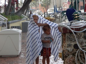 Mattie and Ethan got caught in a rain shower coming back from the pool.  Matthew put his towel around Ethan.