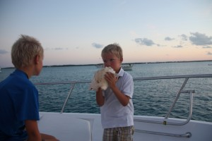 Matthew blowing his conch.  James prefers not to try.