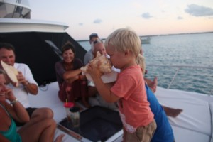 Ethan having a go at the conch.  We had supper at the boat Family Business who we met through Celebration.