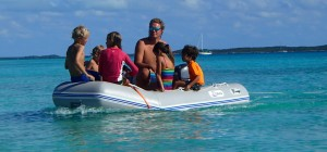 Richard and the kids taking dinghy rides and towing a little wake board
