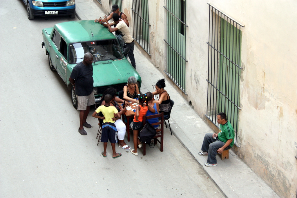 Friday night on the street in Havana... dominoes, music and family.