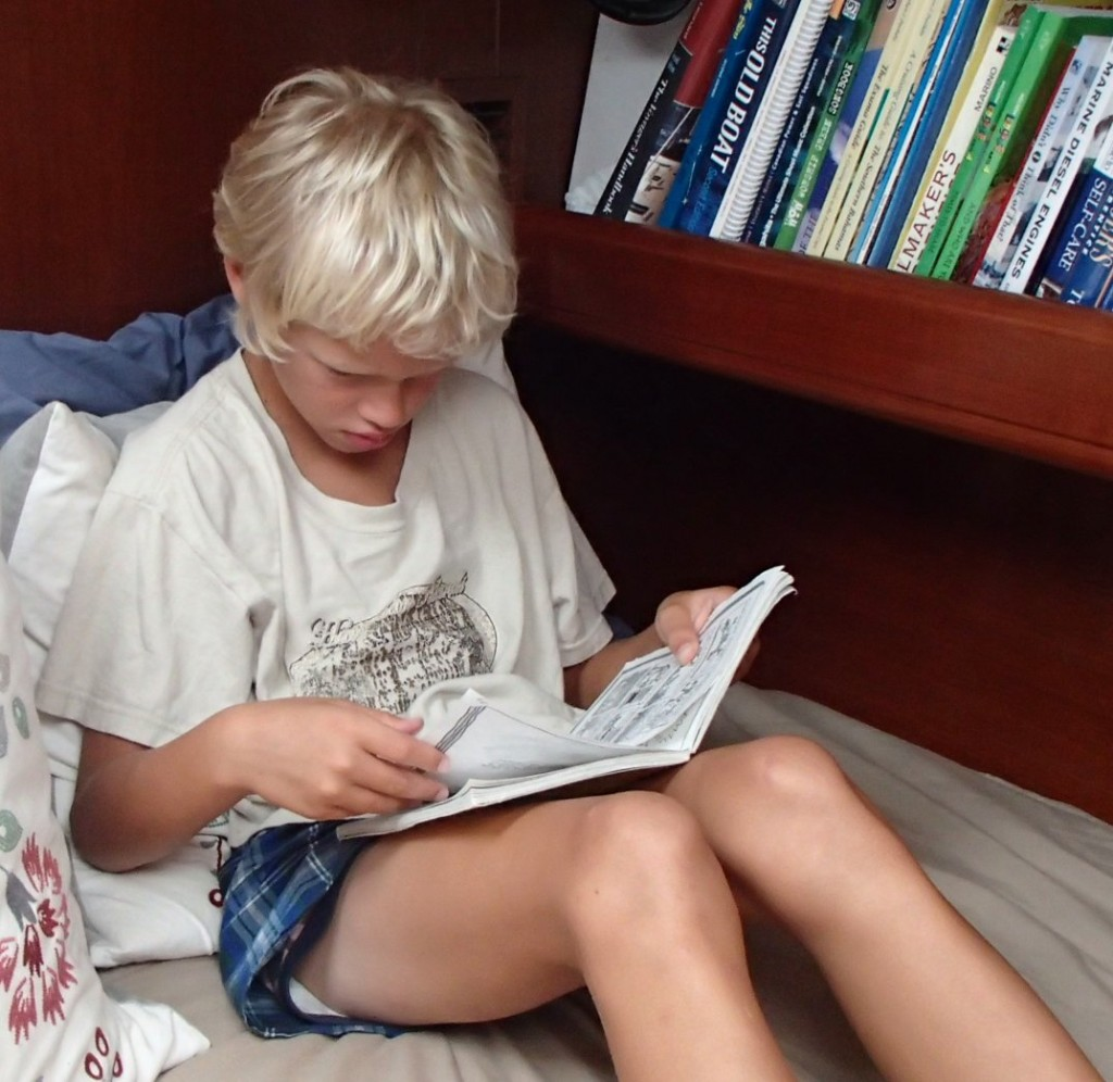 James' favorite thing to do, read quietly on Mom's bed.