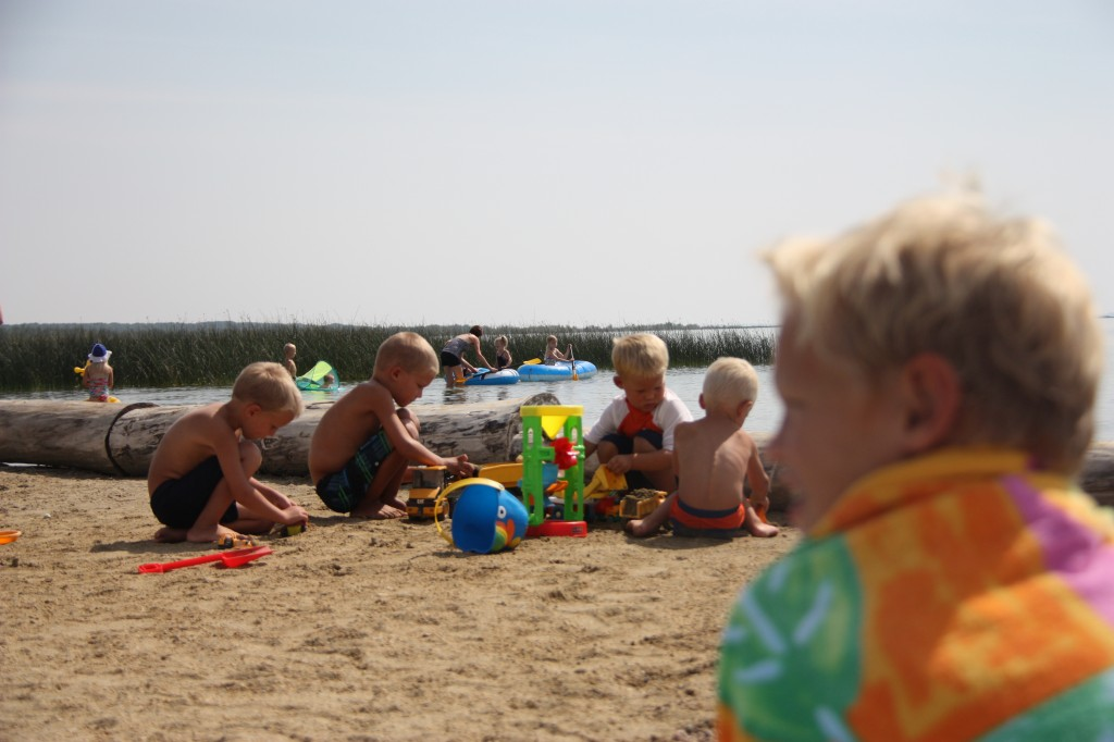 Look at the little squatters!  Milo, Matthew, Ethan and Kiam playing in the sand.  James in the foreground sitting with the grown-ups.