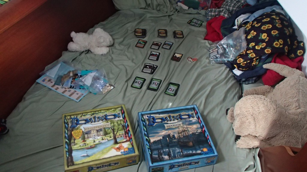 A game of Dominion all set up in the boy's bedroom.