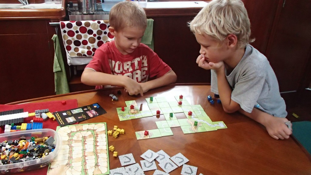 James and Matthew playing a game of Carcassonne.  They play mostly by the rules, but don't keep score.