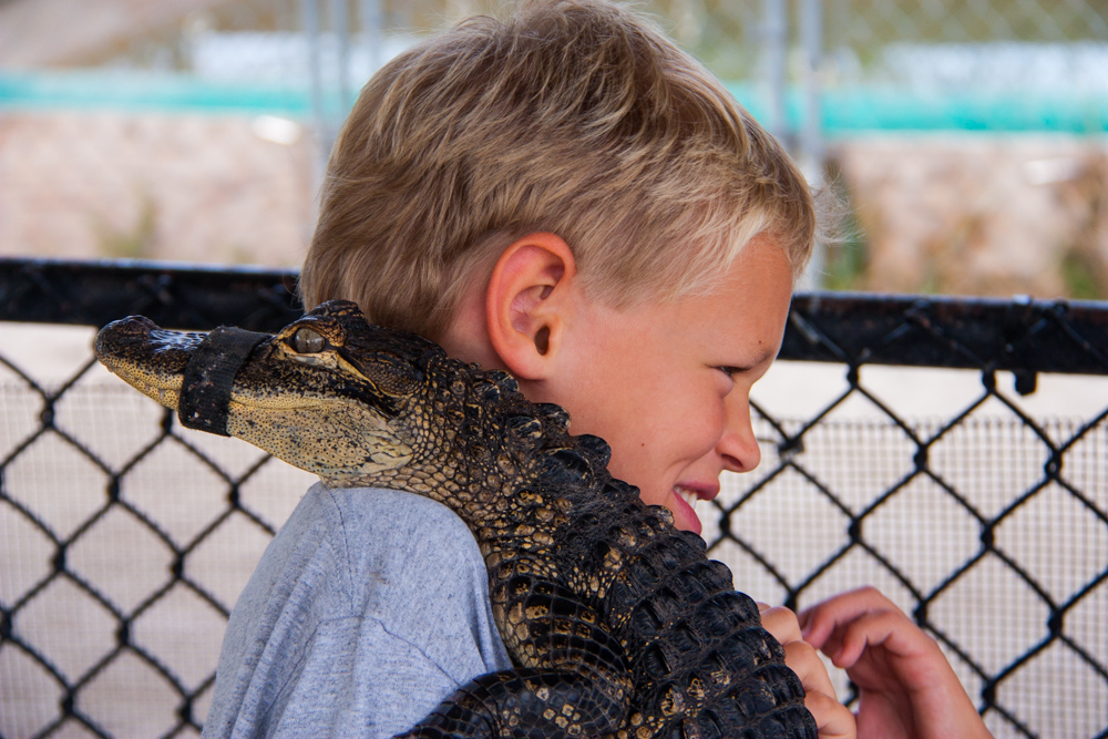 James hugging a Gator.