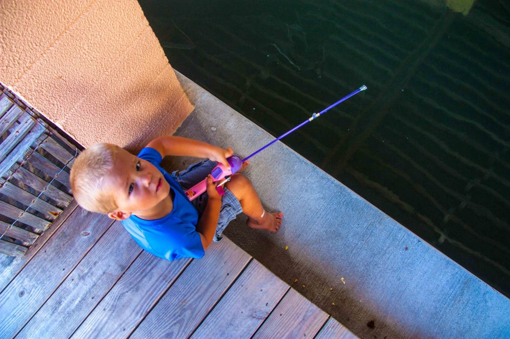 Mooky loved to fish off the dock... he didn't know all he had was weight on the end of the line.