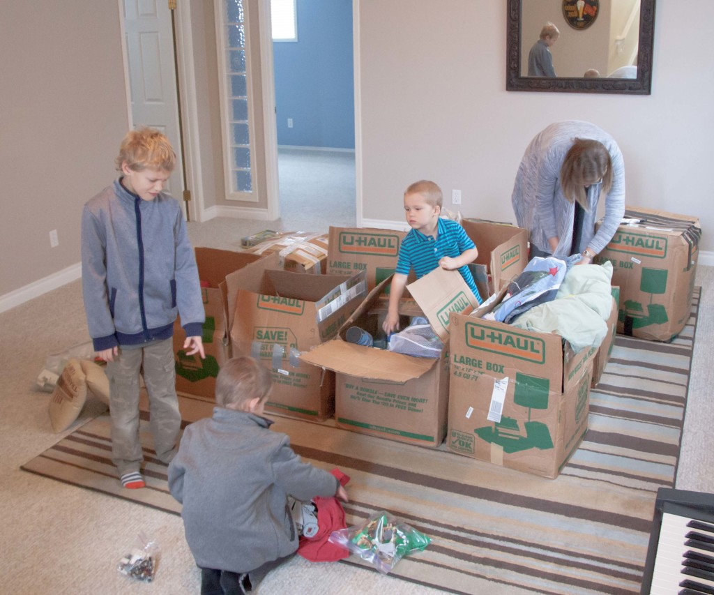 The boys were excited to unearth their treasures from the boxes as they had been in Opa's shop for 3 months