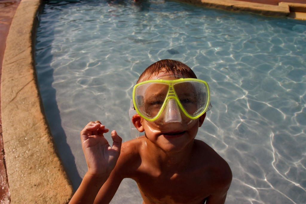 Mattie and his snorkel mask. He doesn't enter the pool without it!