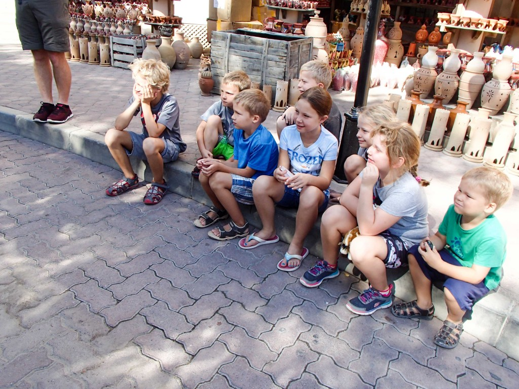The kids gathered in a shady spot in the Nizwa Souq.