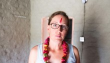 A traditional Barauli welcome into the homestay; red paint on the forehead and a handmade lei made from fresh local flowers.